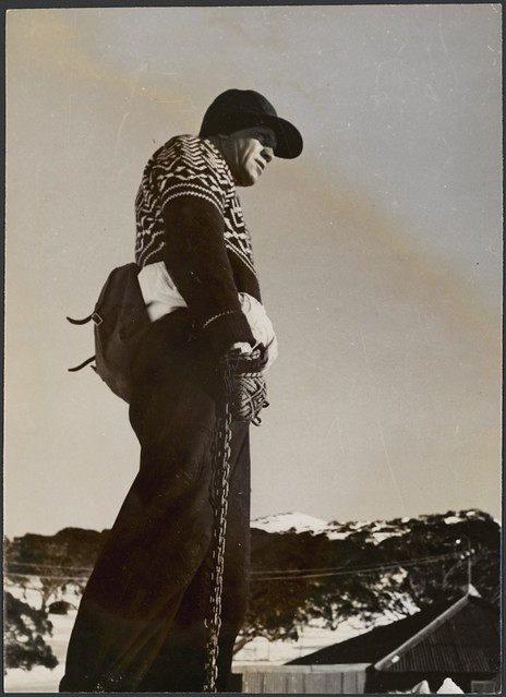 A man with rope tow chain on ski slopes, Snowy Mountains Region, New South Wales, ca. 1942.