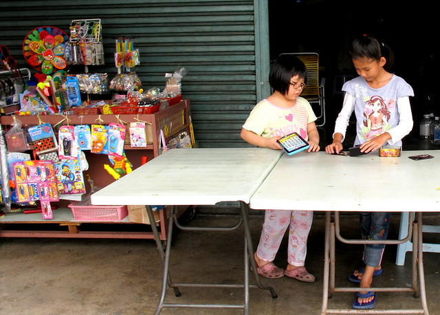 Pulau Ketam, Crab Island - girls mending a stall