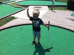 outdoor play equipment(0.0), lawn(0.0), playground(0.0), grass(1.0), play(1.0), recreation(1.0), outdoor recreation(1.0), green(1.0), golf(1.0), miniature golf(1.0),