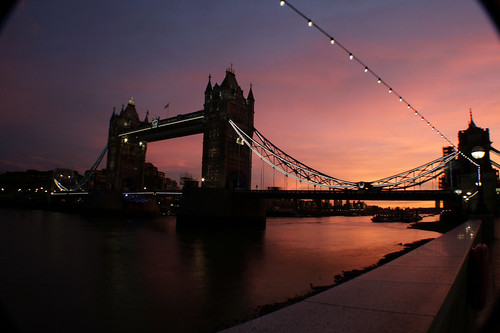 The sun rises over Tower Bridge