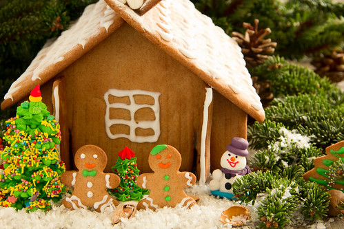 Gingerbread house with decorations, ginger biscuits.