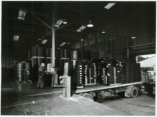 "<p>Title:<br /> Industry<br /> <br /> Publicity Caption:<br /> ""Tyre dispatch bay"" pallet loading on to carrier trucks, at the Dunlop Tyre Factory, Upper Hutt<br /> <br /> Photographer:<br /> J Waddington <br /> <br /> September 1970, Wellington<br /> <br /> Archives New Zealand Reference: AAQT 6539 W3537 106 / A94624 <a href=""https://www.archway.archives.govt.nz/ViewFullItem.do?code=24803442"" rel=""nofollow"">www.archway.archives.govt.nz/ViewFullItem.do?code=24803442</a><br /> <br /> For further enquiries please email research.archives@dia.govt.nz <br /> <br /> Material from Archives New Zealand Te Rua Mahara o te Kāwanatanga</p>"
