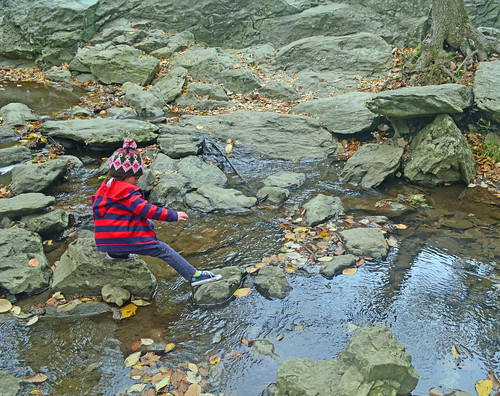 Clara Chambers, 6 years old, hops along the rocks during a recent camping trip with her family. (U.S. Forest Service photo)