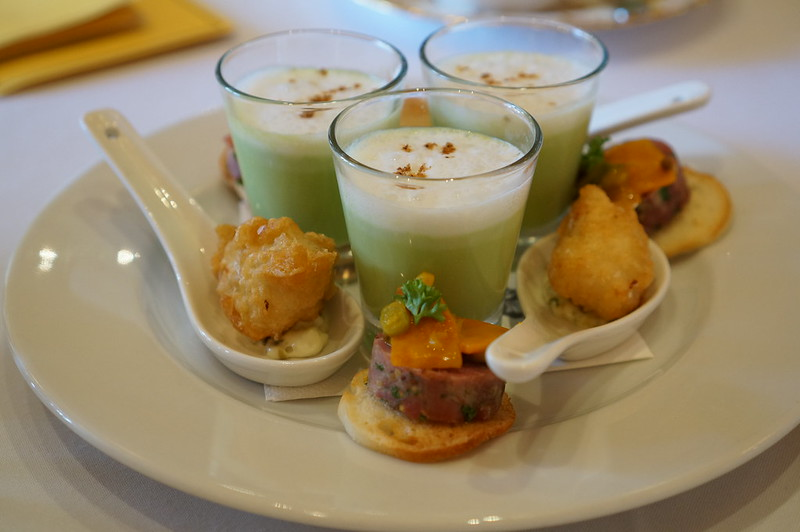 Pea Soup with Coconut Foam, Fish Tempura and Sausage on Crostini