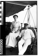The captain of MERSEY possibly seated with his wife