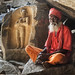 Hampi - The Not so Itinerant Sadhu in the Holy Garb of Seeking Alms by Anoop Negi