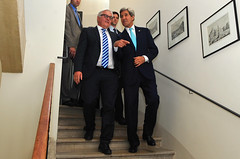 U.S. Secretary of State John Kerry walks with German Foreign Minister Frank-Walter Steinmeier in a hotel staircase in Vienna, Austria, on July 13, 2014, before they held a bilateral meeting amid broader P5+1 talks with Iran about its nuclear program. [State Department photo/ Public Domain]
