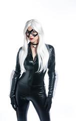 black hair(0.0), textile(0.0), fetish model(1.0), latex clothing(1.0), clothing(1.0), leather(1.0), blond(1.0), costume(1.0), adult(1.0),