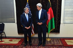 U.S. Secretary of State John Kerry appears before reporters with Afghan presidential candidate Abdullah Abdullah on July 11, 2014, after he arrived at the U.S. Embassy in Kabul, Afghanistan for a meeting about steps to resolve the country's disputed presidential election between him and fellow candidate Ashraf Ghani. [State Department photo/ Public Domain]