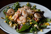 White wine and butter sauteed shrimp and grilled corn over mesclun