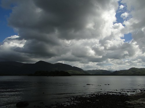 lighting ireland irish sunlight nature wet water clouds rural countryside movement scenery mood shadows natural shoreline lakes atmosphere eire kerry lakeside hills views killarney vista celtic geology distance cloudscape atmospheric rossisland