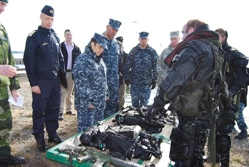 Mon, 04/03/2017 - 09:10 - 170403-N-N0901-004 HANINGE GARRISON, Sweden (April 3, 2017) Swedish assault divers discuss their equipment with Adm. Michelle J. Howard, commander, U.S. Naval Forces Europe-Africa, and Fleet Master Chief Raymond D. Kemp during a visit to Haninge Garrison, April 3, 2017. U.S. Naval Forces Europe-Africa, headquartered in Naples, Italy, oversees joint and naval operations, often in concert with allied, joint, and interagency partners, to enable enduring relationships and increase vigilance and resilience in Europe and Africa. (Courtesy photo by Swedish Maj. Kristina Swaan/Released)