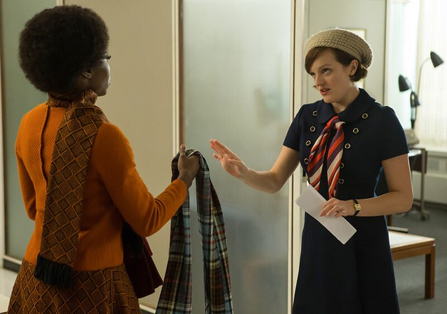 Peggy wearing a cool outfit talking to Shirley, also wearing a cool outfit