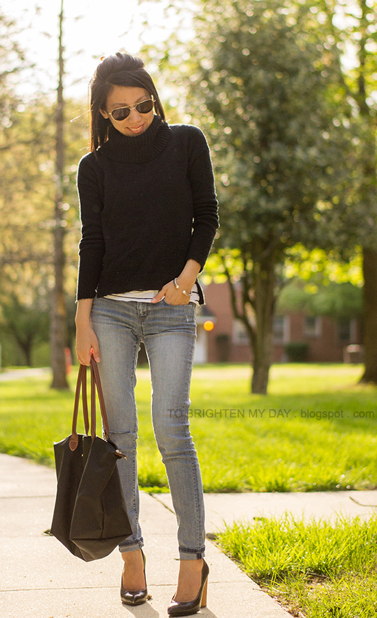 black cowlneck sweater, striped top, light wash jeans