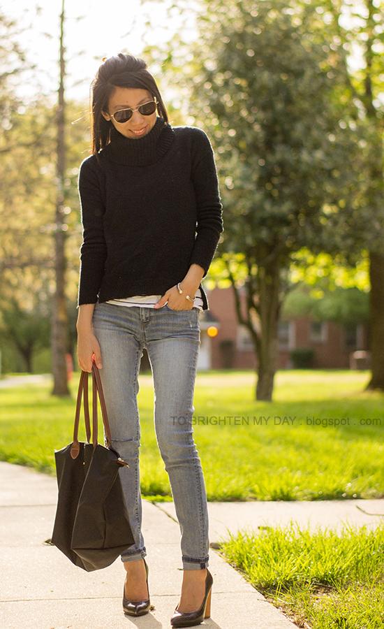 black cowlneck sweater, striped top, light wash jeans