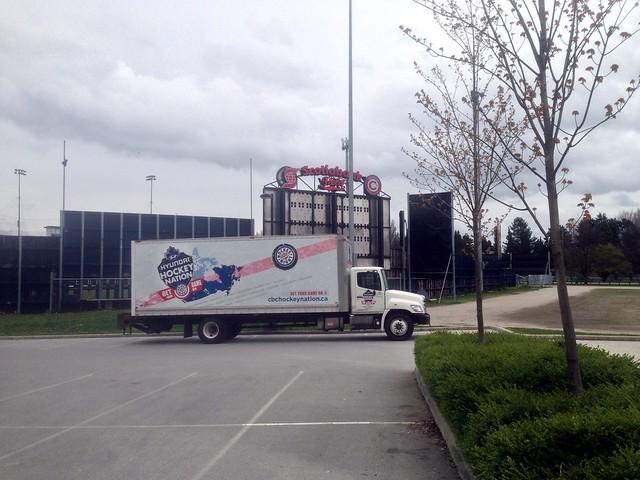 Hockey truck parked next to a baseball stadium