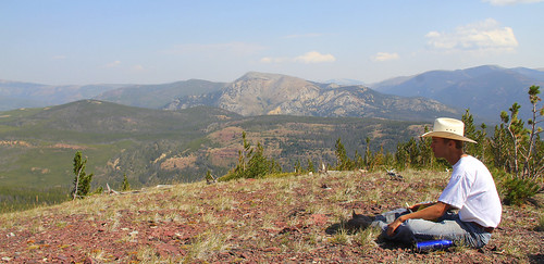 "Jackson Hart of Missoula, Montana, has a panoramic view of the Scapegoat Wilderness Area as he writes in his journal during the filming of ""Untrammeled The trip and video were done with the support and collaboration of partners and the Forest Service, as part of a year-long commemoration of the Wilderness Act of 1964. (U.S. Forest Service)"