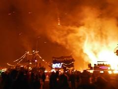 rock concert(0.0), bonfire(0.0), crowd(1.0), fire(1.0), flame(1.0), explosion(1.0),