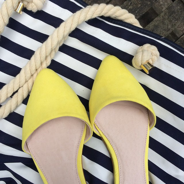 Yellow two part flats and striped beach bag from Next.