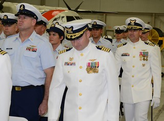 Capt. Todd W. Lutes inspects the crew of Coast Guard Air Station Miami during a change of command ceremony in Miami, July 2, 2014. Lutes served as the Coast Guard 7th District incident management branch chief, responsible for search and rescue, maritime environmental protection and maritime environmental response in the southeast United States and the Caribbean Basin. (U.S. Coast Guard photo by Petty Officer 3rd Class Mark Barney)