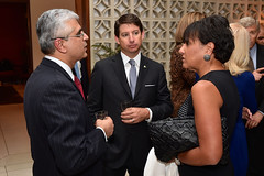 U.S. Commerce Secretary Penny Pritzker and U.S. Department of State Special Representative for Commercial and Business Affairs Scott Nathan chat with Tarun Chugh of PNB Metlife before a working dinner on July 30, 2014, with Indian and American businessmen at Roosevelt House - the U.S. Ambassador's Residence in New Delhi, India - after the pair joined U.S. Secretary of State John Kerry in traveling to the country for a Strategic Dialogue with their Indian counterparts. [State Department photo/ Public Domain]