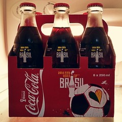liqueur(0.0), beer(0.0), alcoholic beverage(0.0), soft drink(1.0), carbonated soft drinks(1.0), bottle(1.0), drink(1.0), cola(1.0), coca-cola(1.0), brand(1.0),