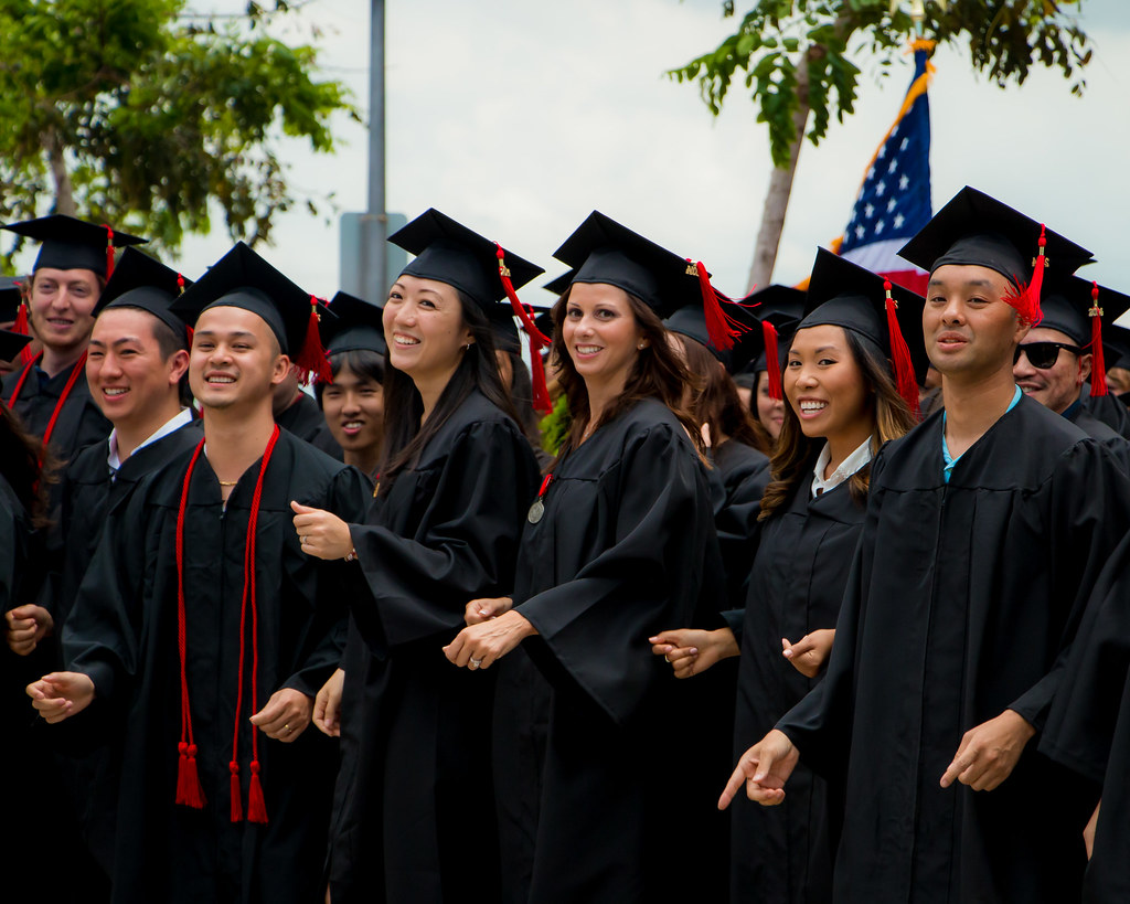 """<p>UH West Oahu graduates break into a flash mob dance performance after receiving diplomas. The entire 2014 graduating class performed to Pink's """"Raise Your Glass"""" to the delight of family and friends. For more photos go to <a href=""""https://www.flickr.com/photos/uhwestoahu/14222094541/"""">www.flickr.com/photos/uhwestoahu/14222094541/</a></p>"""