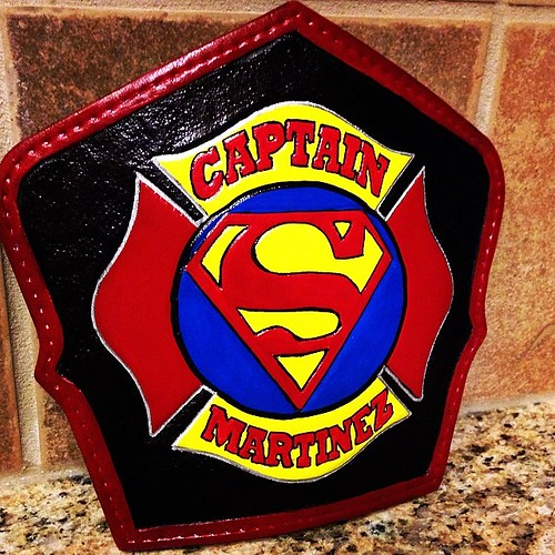 Superman's fire helmet shield.  Black with superman maltese.