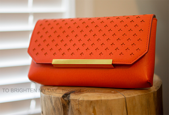 J.Crew Claremont perforated clutch in sunbaked orange