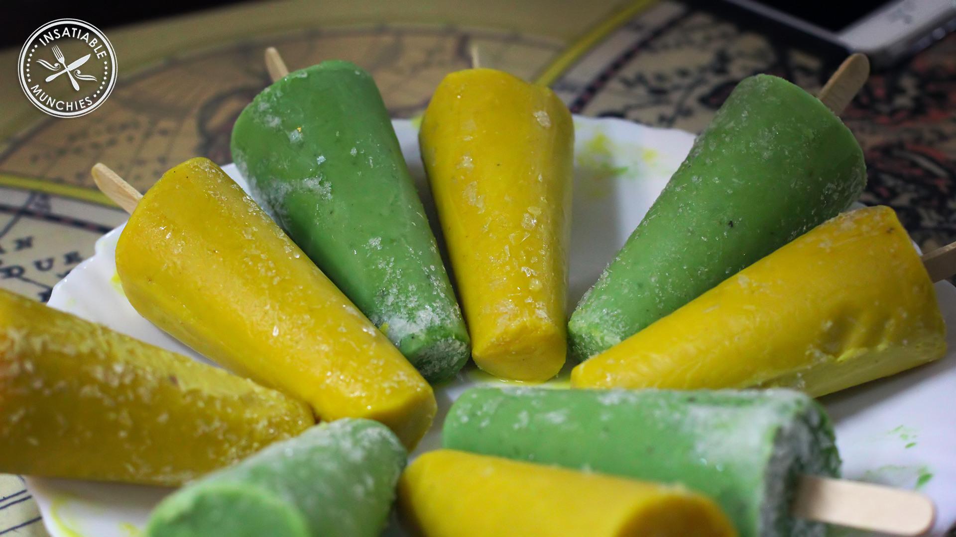 Yellow mango kulfi, alternated with green pistachio kulfi. Frozen onto popsicle sticks