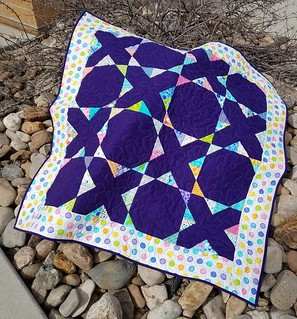 Brighten up baby quilt really brightens up the dead bushes this first day of spring. #igquiltfest #scrapquilt #charmsquares