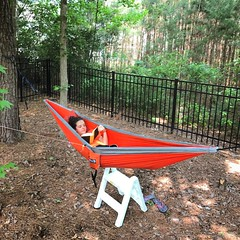 "Hannah is enjoying the ""easy"" life of a teenager relaxing, reading, & swinging in her ENO in the backyard. #eno"