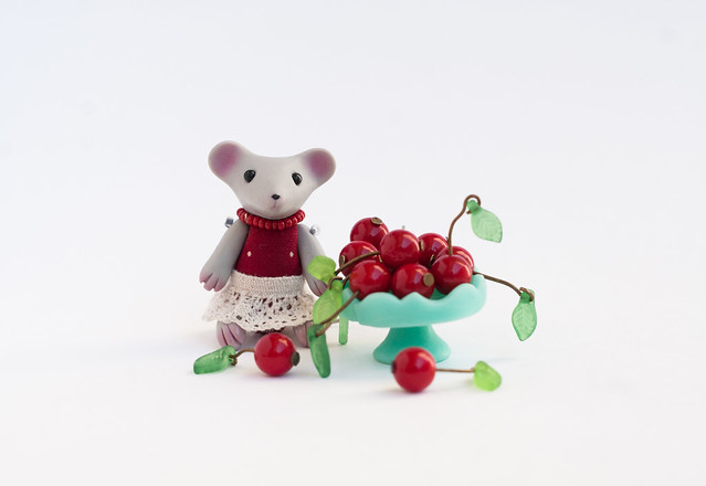 tiny mouse with cherry