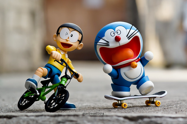S.H. Figuarts Nobita and Robot Spirits Doraemon on their bike and skateboard