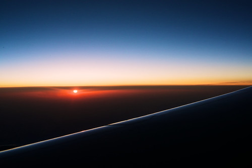 morning sky sun clouds plane sunrise flying asia flight wing windowseat