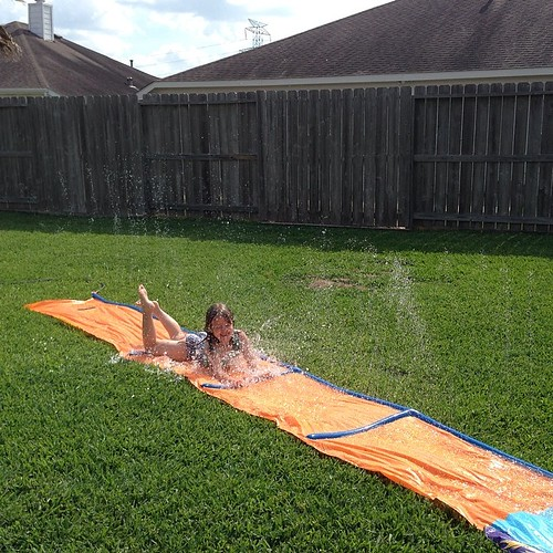 145:365 She has 2 more weeks of school, but we still kicked off Summer today with a new Slip N Slide.