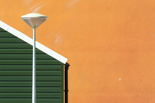 Street lamp, house and wall