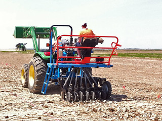 Picture of a planter in a test field planting rice