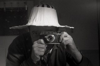 reflected self-portrait with Zorki ! camera and fan hat