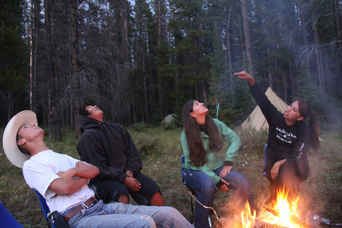 "Youth who were part of the filming of ""Untrammeled"" marvel at the stars appearing overhead, as twilight descends on camp in the Scapegoat Wilderness. (U.S. Forest Service)"