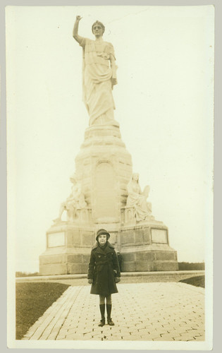Girl with Statue