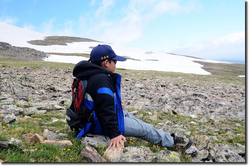 Jacob is resting on his way to James Peak 2
