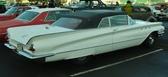automobile(1.0), automotive exterior(1.0), vehicle(1.0), mercury montclair(1.0), full-size car(1.0), antique car(1.0), sedan(1.0), classic car(1.0), vintage car(1.0), land vehicle(1.0), luxury vehicle(1.0), convertible(1.0),
