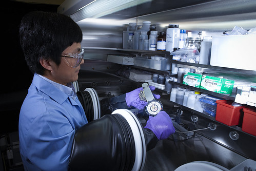 Materials scientist Xiaochuan Lu assembles a sodium-beta battery in a glove box