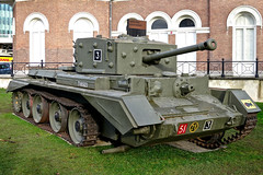 army(0.0), churchill tank(0.0), m113 armored personnel carrier(0.0), armored car(1.0), combat vehicle(1.0), military vehicle(1.0), weapon(1.0), vehicle(1.0), tank(1.0), self-propelled artillery(1.0), gun turret(1.0), land vehicle(1.0), military(1.0),