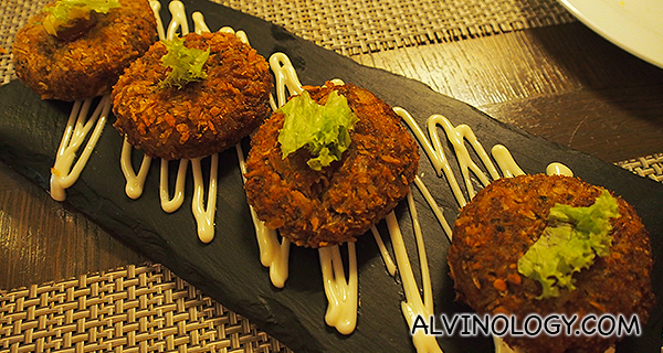 Nadru Kabab - pan-grilled lotus root or stem marinated with red chili and dusted with roasted mint leaves, sandalwood