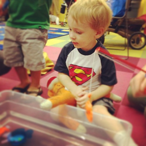 "Waiting his turn at the fishing hole. Notice ""baby"" has #sharpie on him. #heismine #toddler #library"