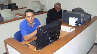 Miguelángel Pérez and Abel Garcia at their computer screens.