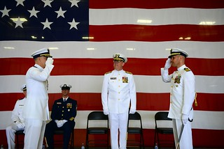 With a salute, Coast Guard Capt. Bruce Jones (left) passes his command of Sector Columbia River to Capt. Daniel Travers during the sector's change of command ceremony held in Warrenton, Ore., June 27, 2014. Coast Guard Rear Adm. Richard Gromlich, commander, Thirteenth Coast Guard District, oversaw the proper change of command from Jones to Travers. (U.S. Coast Guard photo by Petty Officer 1st Class David Mosley)