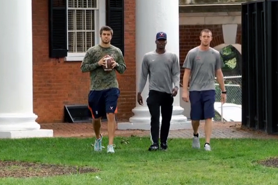 July 11, 2014 - Virginia's quarterbacks take part in a throwing competition on The Lawn.